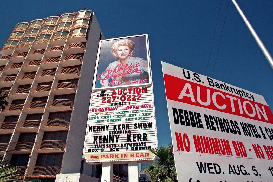 A sign outside the Debbie Reynolds in Las Vegas on Aug. 5, 1998, posts a bankruptcy auction of ...
