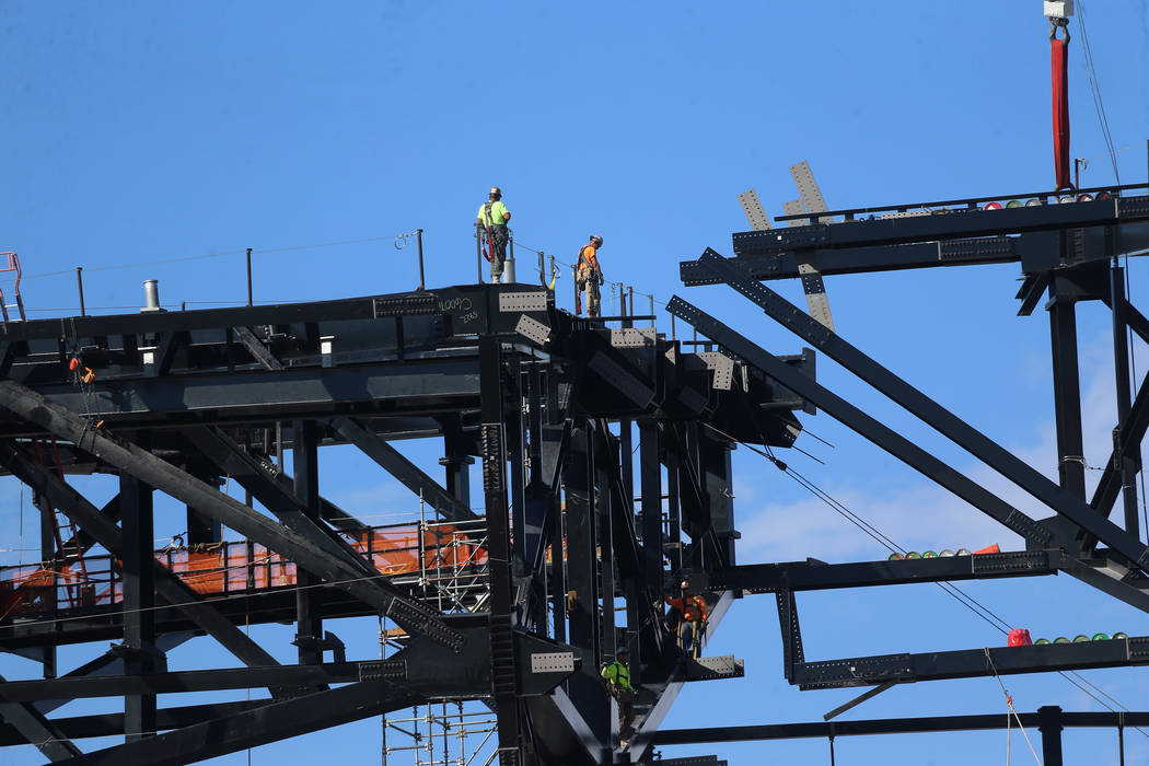 The final steel canopy truss goes up at the Raider stadium construction site in Las Vegas, Thur ...