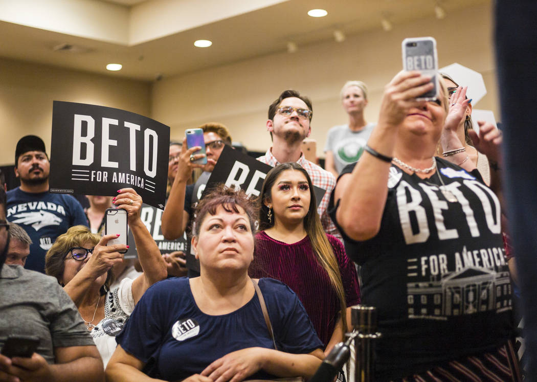 Attendees listen to Democratic presidential candidate and former Texas congressman Beto O'Rourk ...