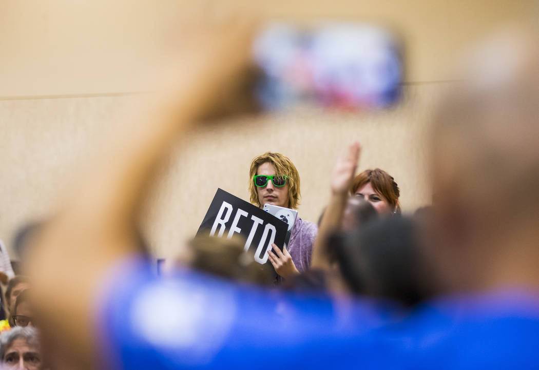 An attendee holds up a sign in support of Democratic presidential candidate and former Texas co ...