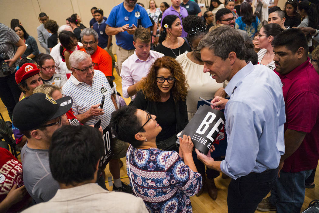 Democratic presidential candidate and former Texas congressman Beto O'Rourke talks with support ...
