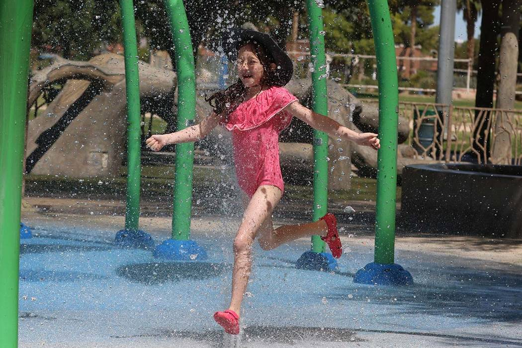 Elle Edwards, 7, cools herself as she plays at Sunset Park, July 29, 2019, in Las Vegas. (Bizua ...