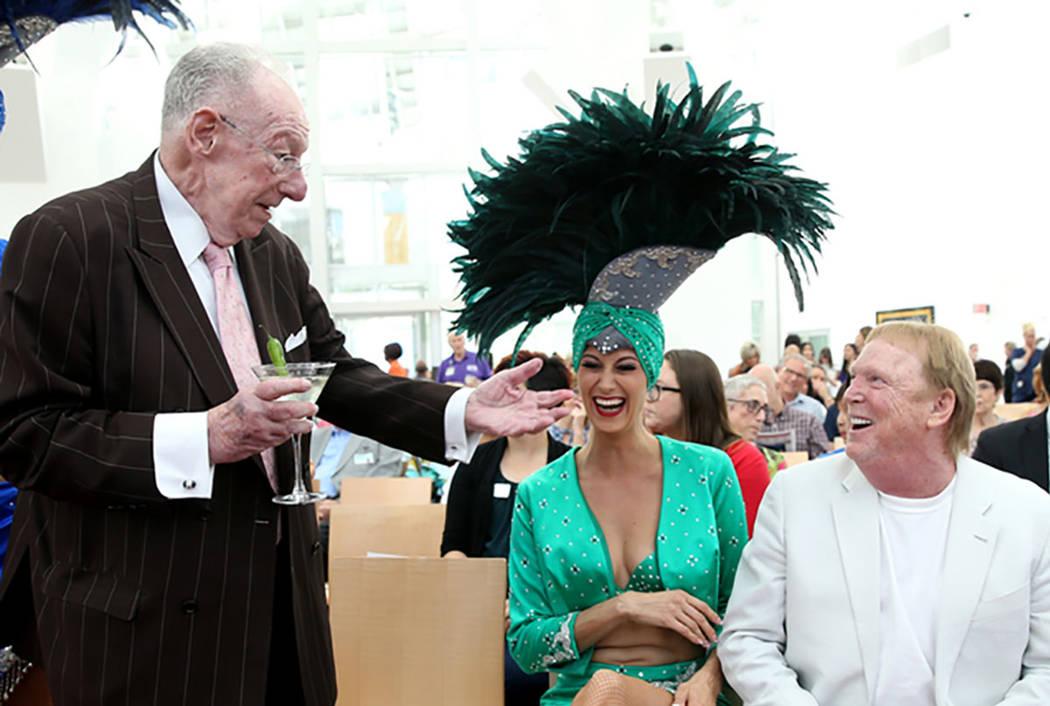 Former Las Vegas Mayor Oscar Goodman, left, with showgirl Carolin Feigs, greets Raiders owner M ...