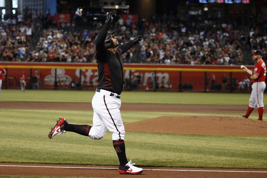 Arizona Diamondbacks' Eduardo Escobar, left, celebrates his two-run home run against Washington ...