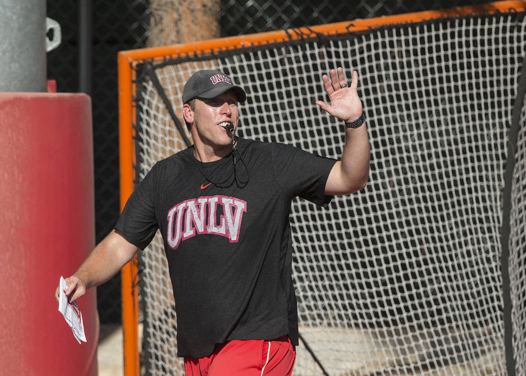 UNLV offensive coordinator Garin Justice coaches up the Rebels during the first day of training ...