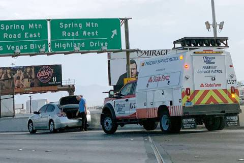 A Freeway Service Patrol member helps a motorist in need on Wednesday, July 31, 2019. (Mick Ake ...