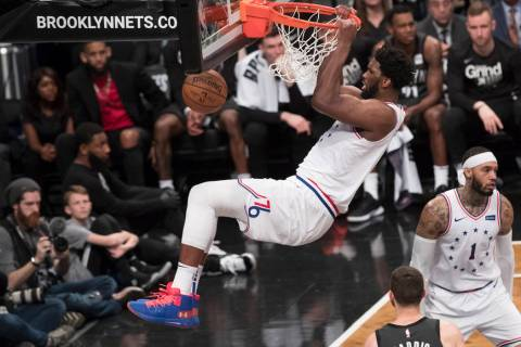 Philadelphia 76ers center Joel Embiid dunks during the second half of Game 4 of a first-round N ...