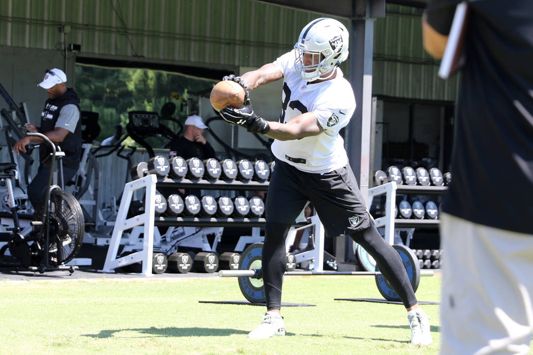 Oakland Raiders tight end Darren Waller (83) catches a ball during a drill at the NFL team's tr ...