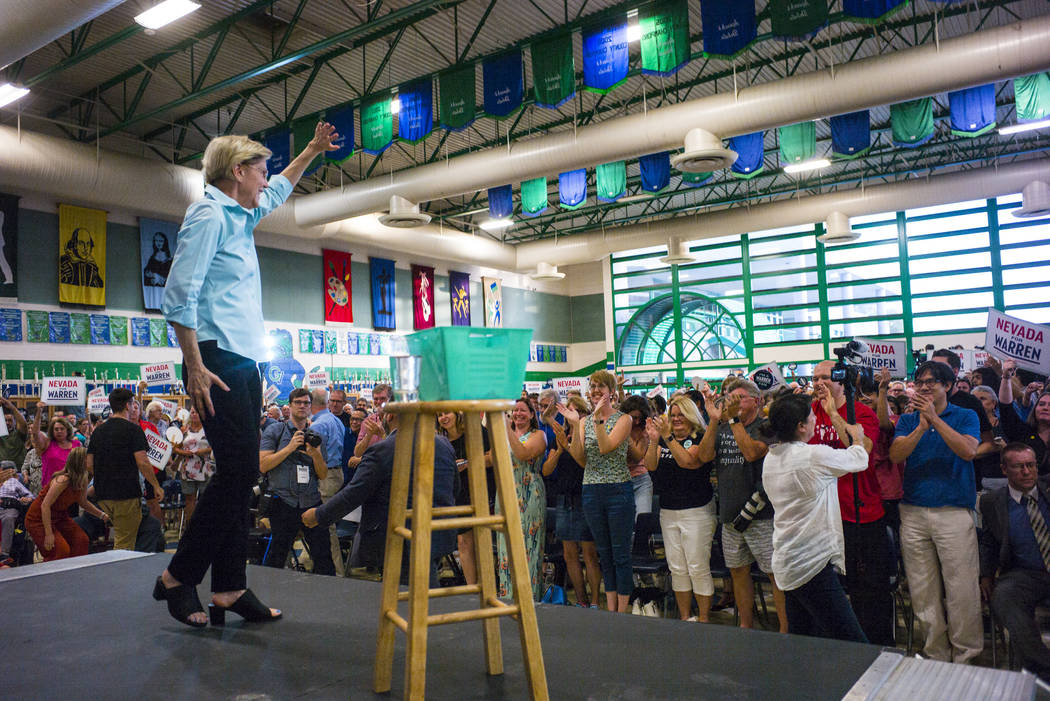 Democratic presidential candidate Sen. Elizabeth Warren, D-Mass., waves to supporters after spe ...