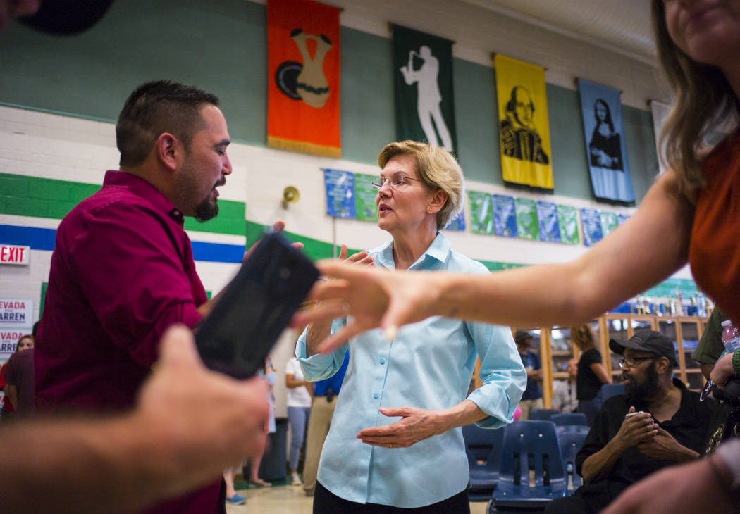 Democratic presidential candidate Sen. Elizabeth Warren, D-Mass., talks with supporters after s ...