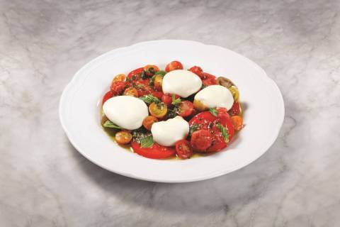 The caprese salad from Carbone is one way to stay cool while eating this summer. (MGM Resorts I ...