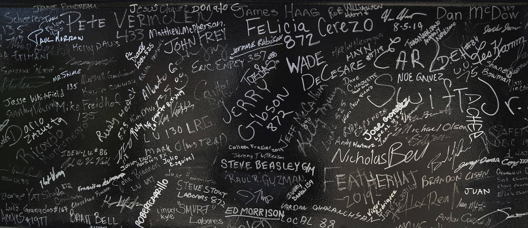 Signatures of workers and dignitaries on a steel beam during the Las Vegas Stadium Topping Out ...
