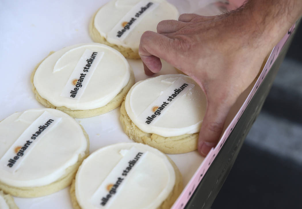 Allegiant Stadium branded cookies are given out to employees during an event to celebrate the n ...