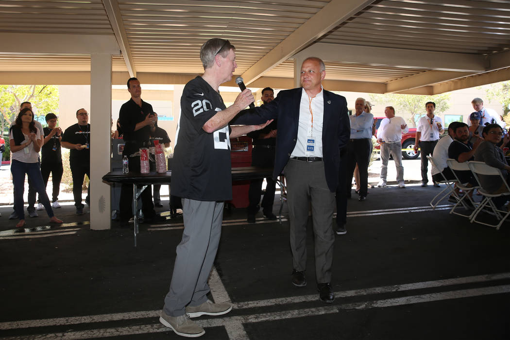 Allegiant Chairman and CEO Maury Gallagher, left, with Raiders president Marc Badain, during a ...