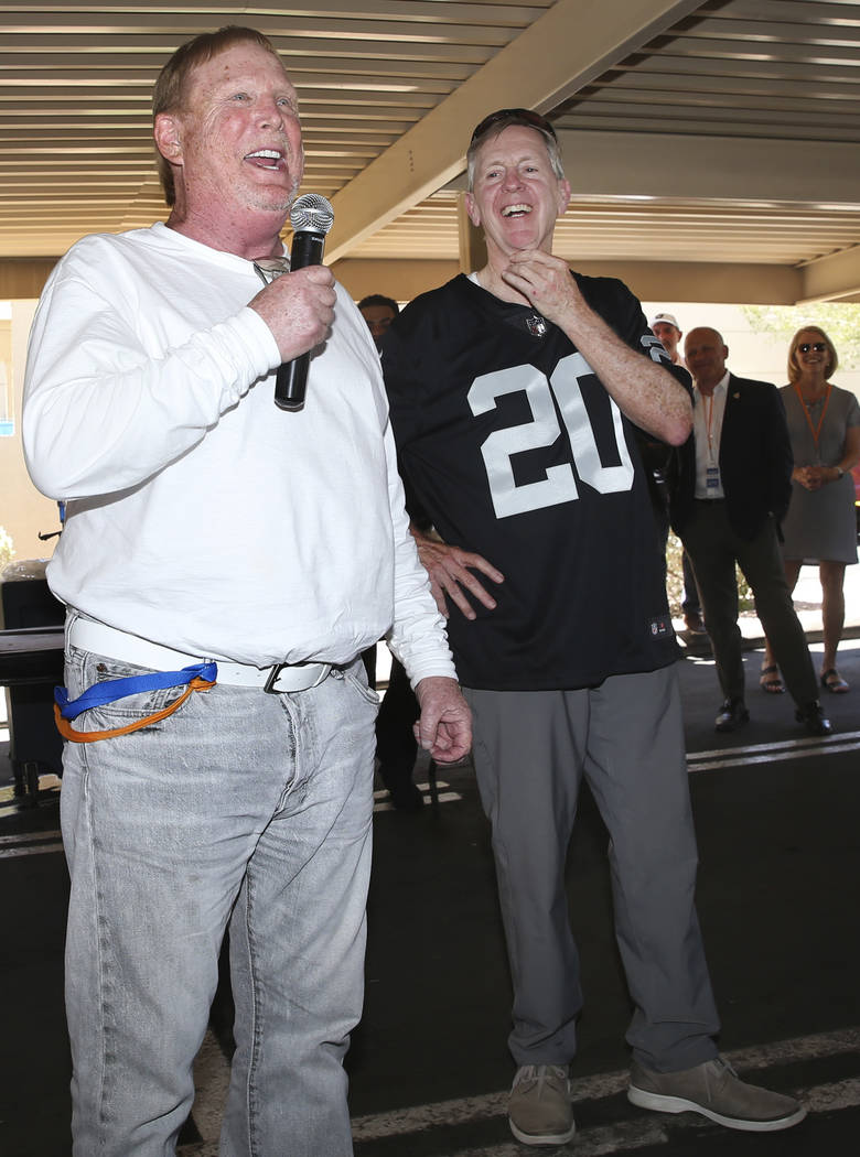 Raiders Owner Mark Davis, left, with Allegiant Chairman and CEO Maury Gallagher, speaks during ...
