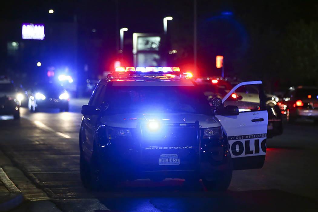 Las Vegas police gather outside of University Medical Center in Las Vegas on Saturday, July 20, ...