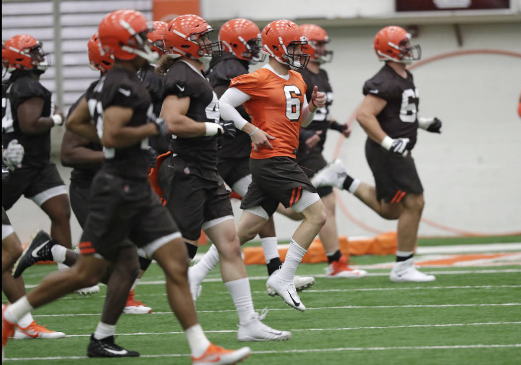 FILE - In this May 4, 2018, file photo, Cleveland Browns quarterback Baker Mayfield (6) runs a ...