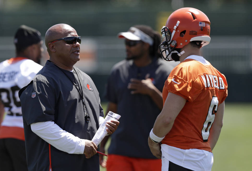 Cleveland Browns head coach Hue Jackson, left, talks with quarterback Baker Mayfield during NFL ...