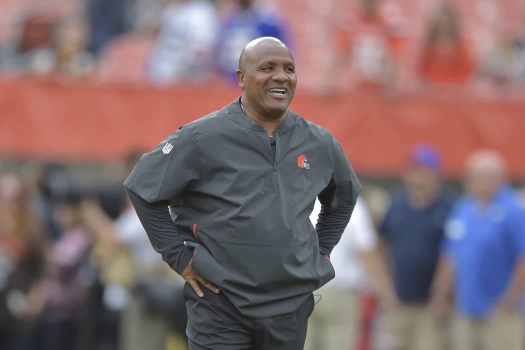 Cleveland Browns head coach Hue Jackson walks on the field before an NFL football preseason gam ...
