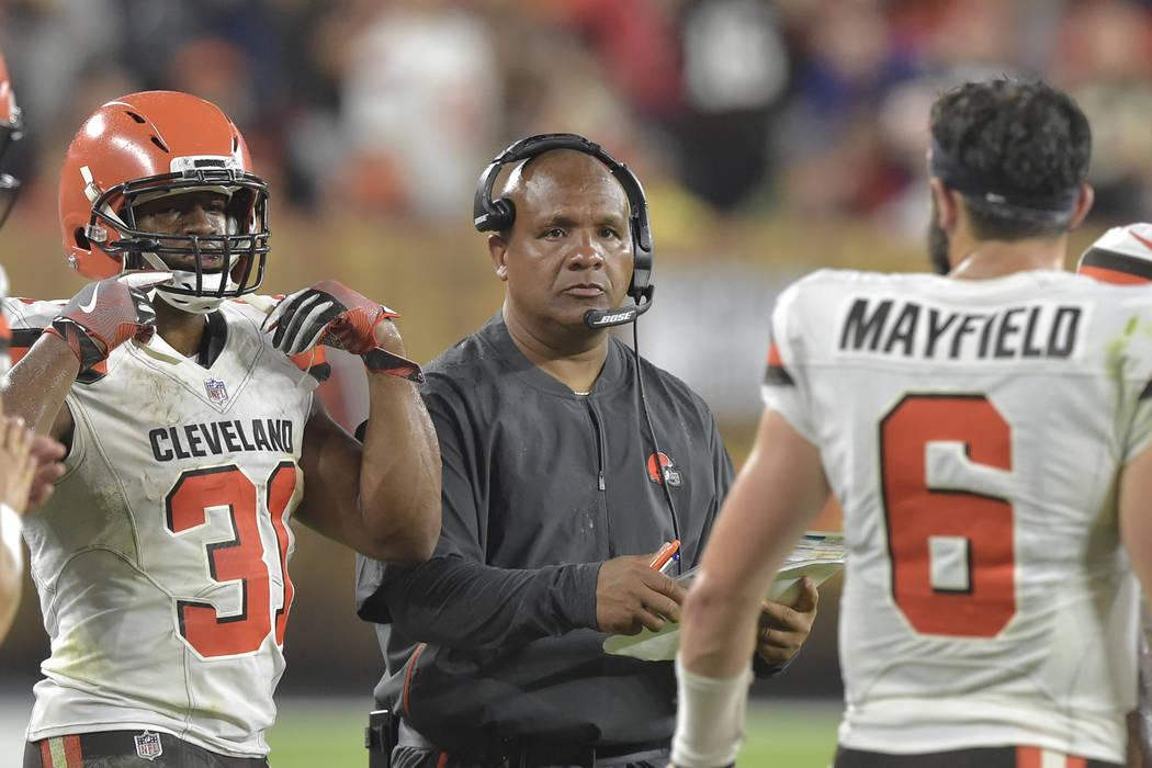 Cleveland Browns head coach Hue Jackson walks on the sideline during an NFL football preseason ...