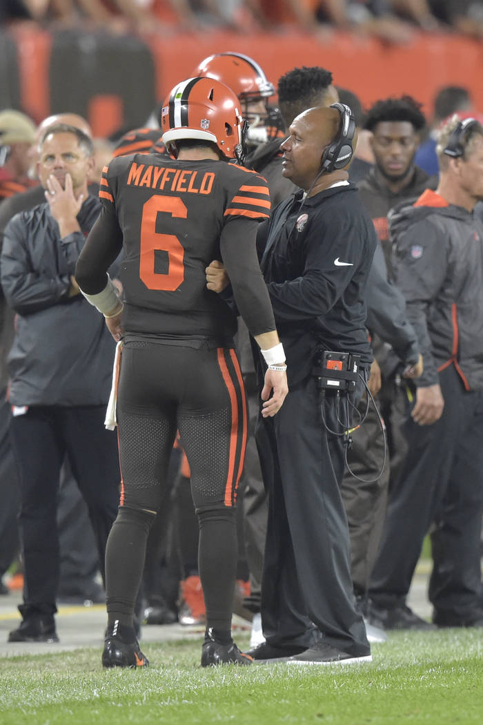 Cleveland Browns quarterback Baker Mayfield talks with head coach Hue Jackson during an NFL foo ...