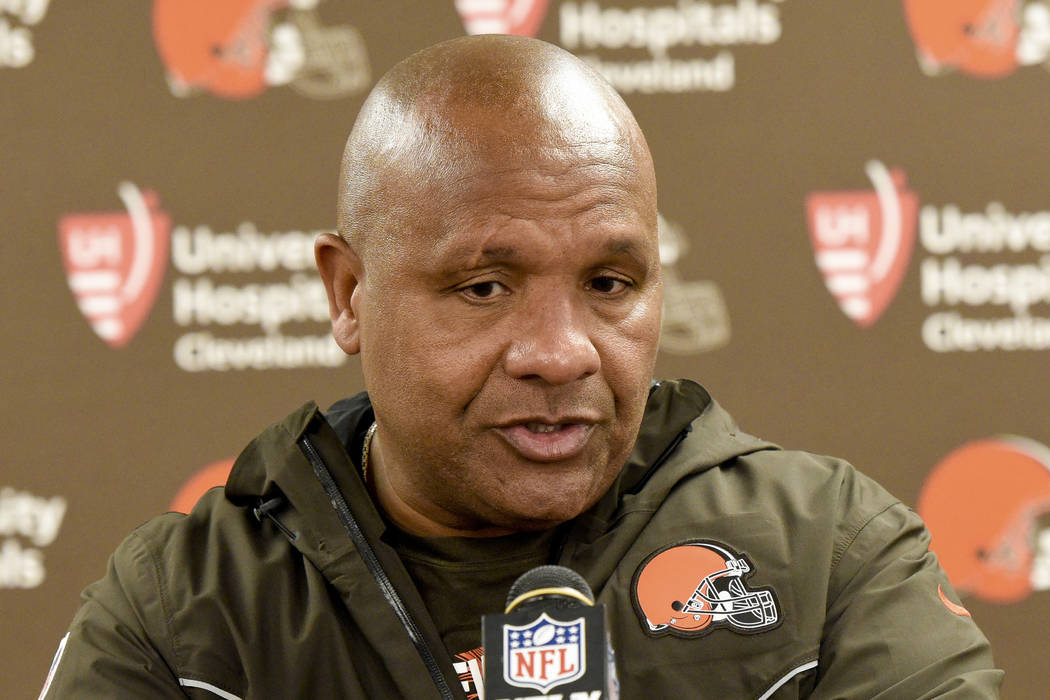 FILE - In this Sunday, Oct. 28, 2018, file photo, Cleveland Browns coach Hue Jackson meets with ...