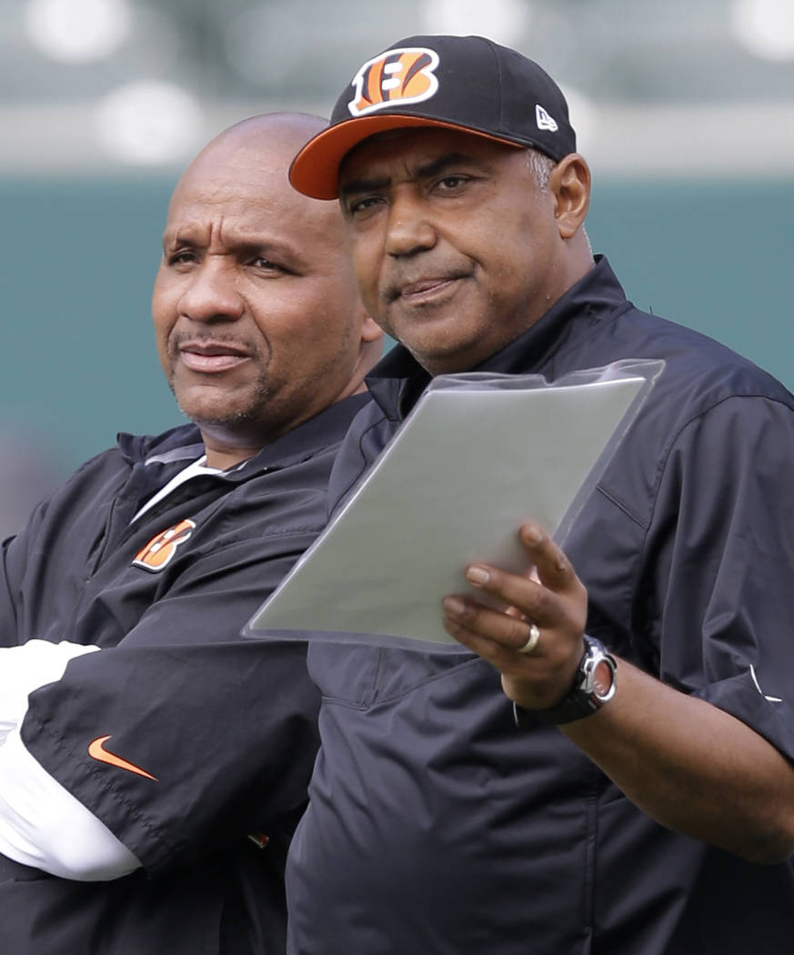 FILE - In this June 3, 2014, file photo, Cincinnati Bengals head coach Marvin Lewis, right, tal ...