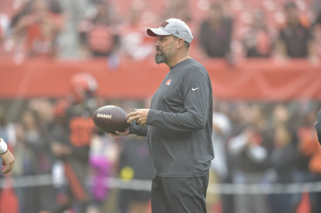 Cleveland Browns offensive coordinator Todd Haley stands on the field before an NFL football ga ...