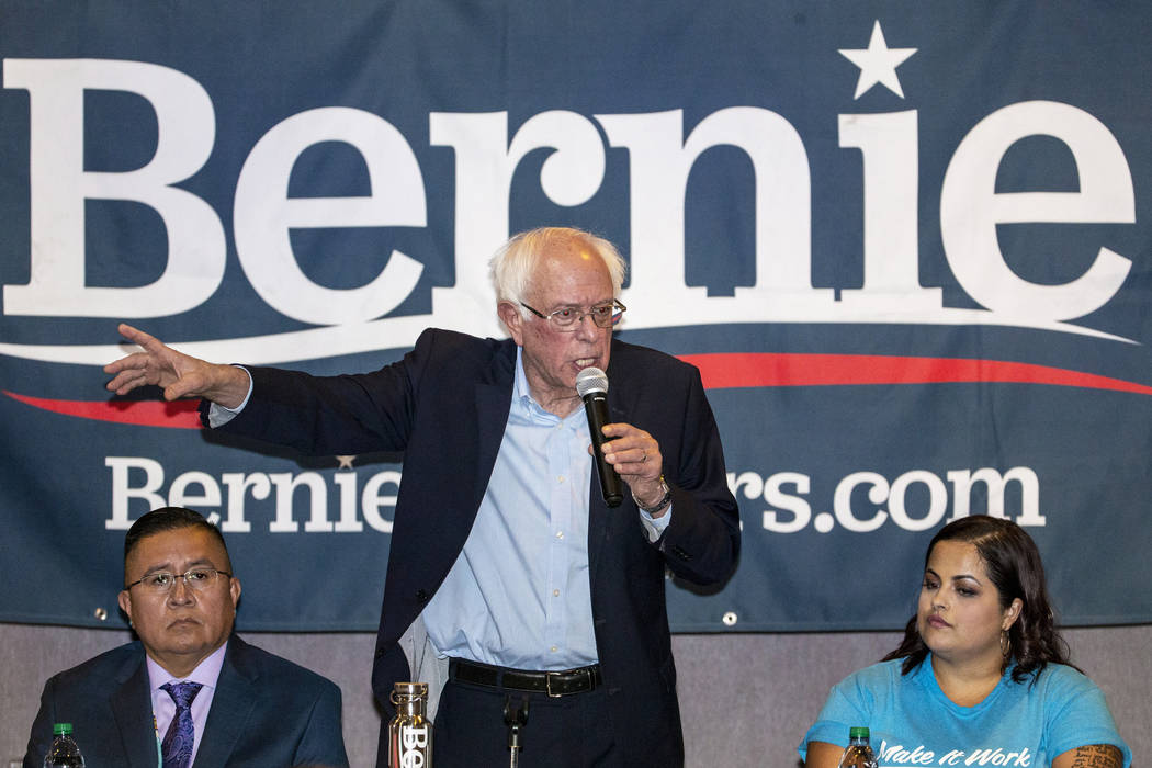 Democratic presidential candidate Sen. Bernie Sanders, I-Vt., center, speaks during and economi ...
