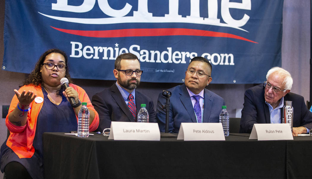 Laura Martin, left, speaks on a panel led by Democratic presidential candidate Sen. Bernie Sand ...