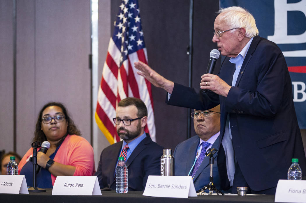 Democratic presidential candidate Sen. Bernie Sanders, I-Vt., right, speaks during and economic ...