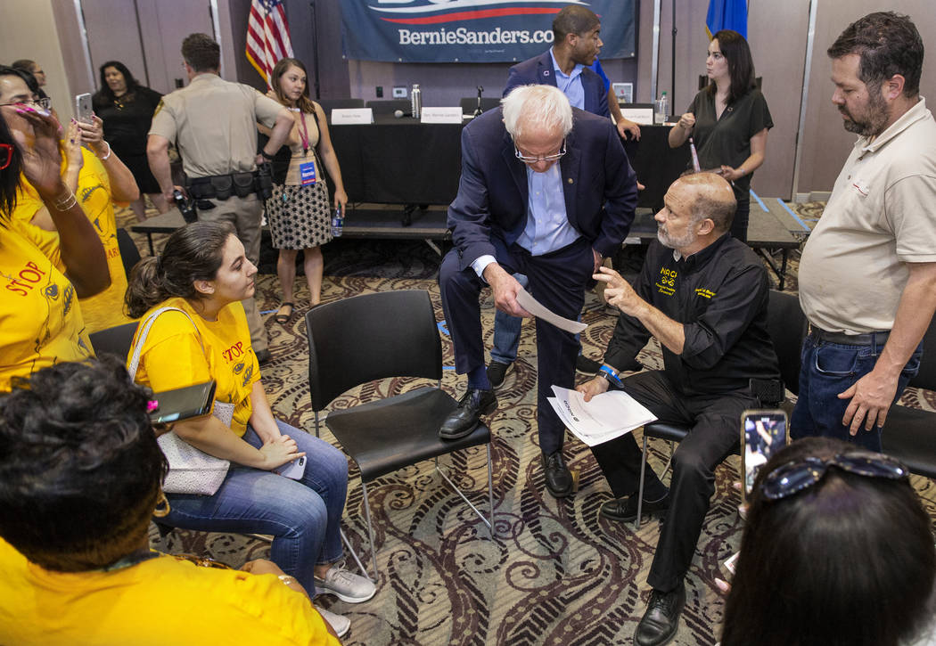Democratic presidential candidate Sen. Bernie Sanders, I-Vt., top/center, listens to an idea by ...