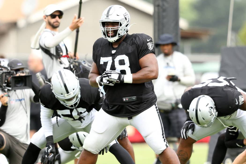 Oakland Raiders defensive tackle Justin Ellis (78) warms up during the NFL team's training camp ...