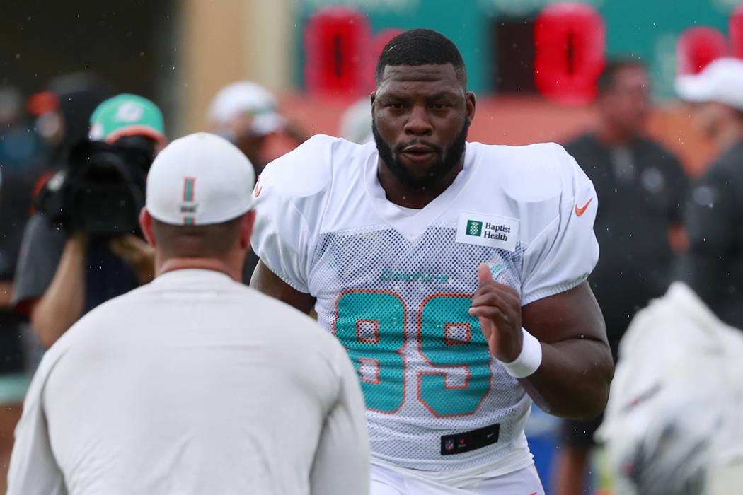 Miami Dolphins tight end Dwayne Allen runs drills at the teams NFL football training camp, Thur ...