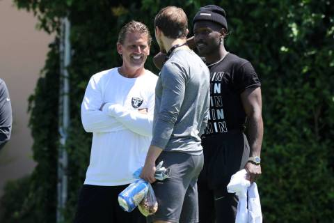 Oakland Raiders wide receiver Antonio Brown (84), right, meets with offensive coordinator Greg ...