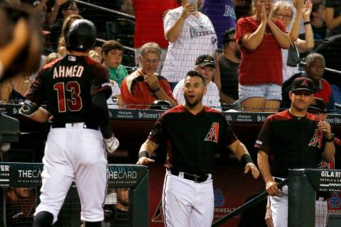 Arizona Diamondbacks shortstop Nick Ahmed (13) arrives back at the dugout after hitting a home ...