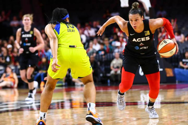 Las Vegas Aces' Kayla McBride drives to the basket against Dallas Wings' Allisha Gray (15) duri ...