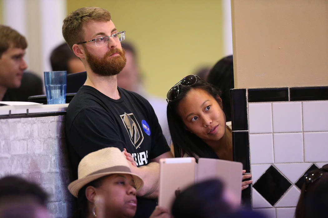 Attendees listen to Democratic presidential candidate former Vice President Joe Biden, out of f ...