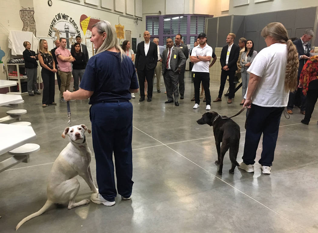 Two inmates who are part of a dog-training program address a tour, which included Democratic pr ...
