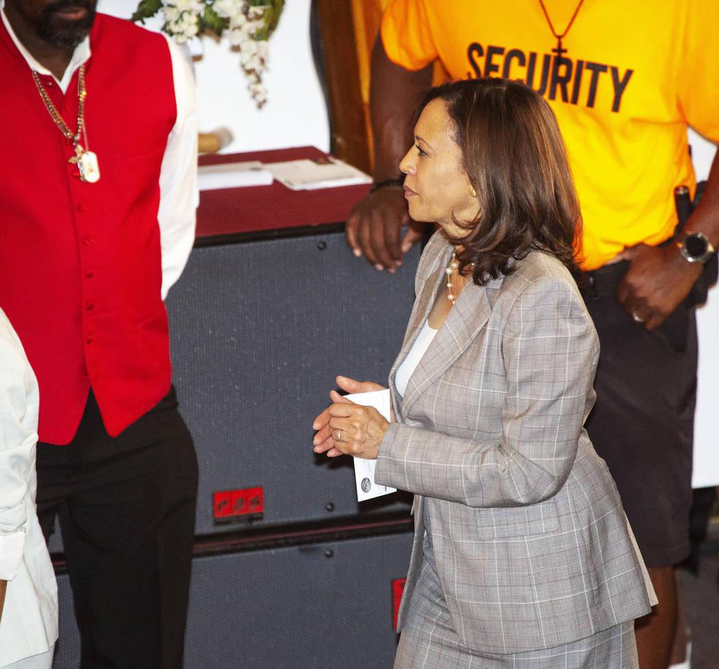 Democratic presidential candidate Sen. Kamala Harris, D-Calif., walks to the front of the churc ...