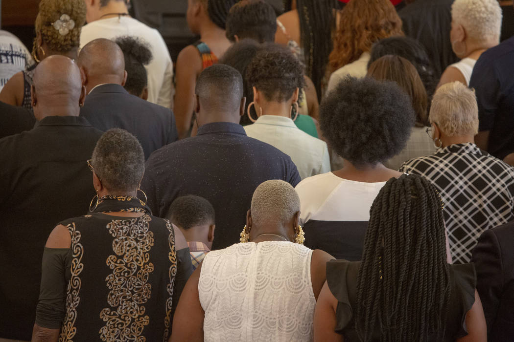 Church goers pray in a group during the second church service, with Democratic presidential can ...
