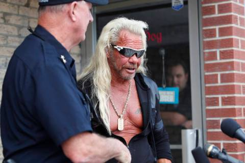 "Duane ""Dog the Bounty Hunter"" Chapman, right greets John Mackey, chief of police of Edgewater, ..."