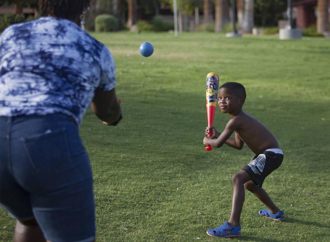 Maureen Edwards tosses a ball to her grandson Xavier Love, 6, at Lorenzi Park in Las Vegas, Sun ...