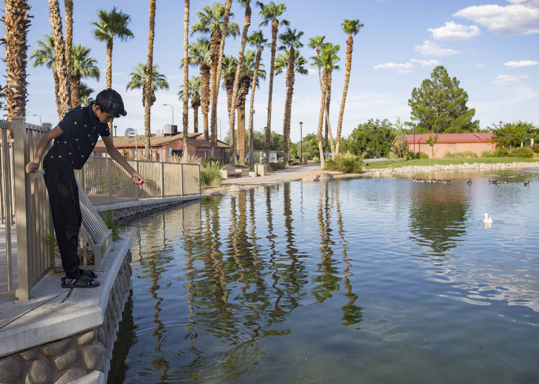 Angel Casares, 15, fishes at the pond at Lorenzi Park in Las Vegas, Sunday, Aug. 4, 2019. An ex ...