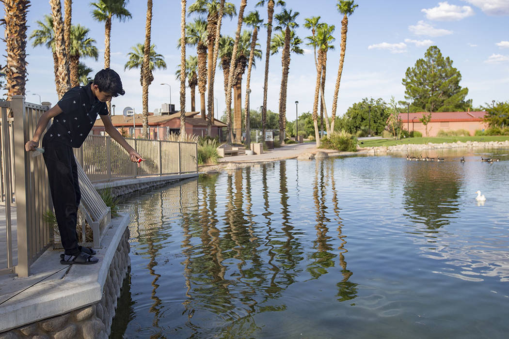 Angel Casares, 15, fishes at the pond at Lorenzi Park in Las Vegas, Sunday, Aug. 4, 2019. (Rac ...