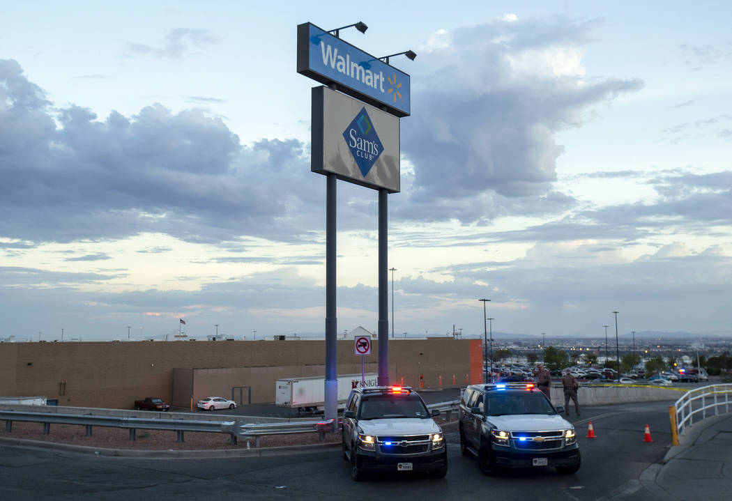 Texas state police cars block the access to the Walmart store in the aftermath of a mass shooti ...