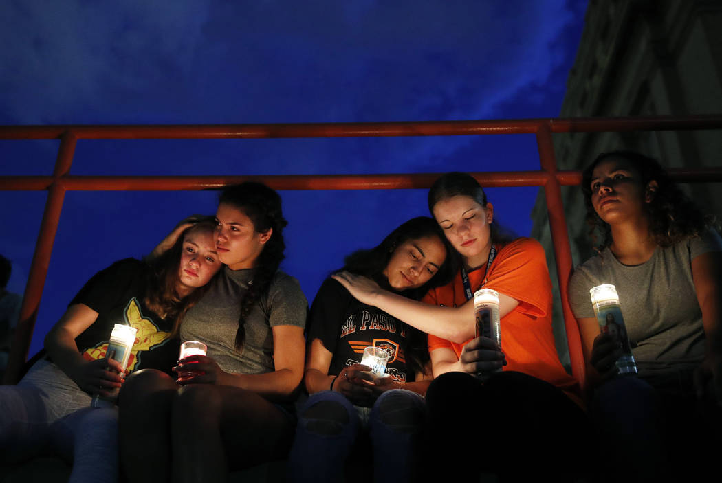 From left, Melody Stout, Hannah Payan, Aaliyah Alba, Sherie Gramlich and Laura Barrios comfort ...