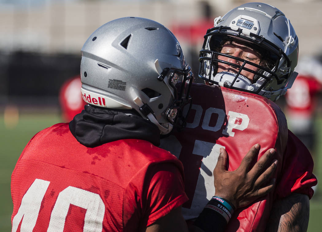 UNLV linebacker Vic Viramontes, right, works through drills during the first day of training ca ...