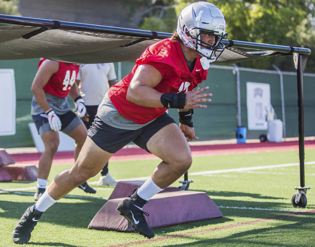 UNLV linebacker Vic Viramontes (10) works through drills during the first day of training camp ...