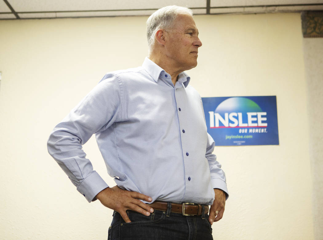 Democratic presidential candidate Washington Gov. Jaylistens to audience questions during his ...